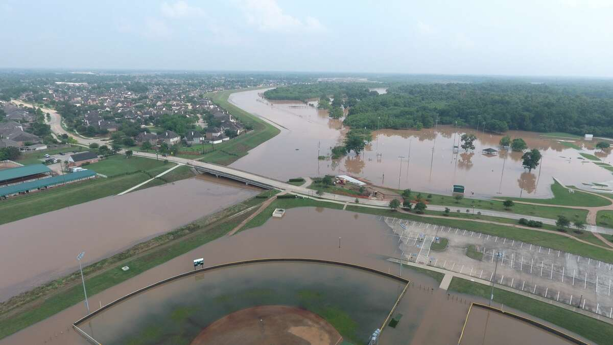 Drone photos show areas of Sienna Plantation that were left inundated from heavy rainfall that hit the entire Houston area Thursday night.