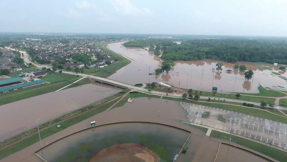 Drone photos show areas of Sienna Plantation that were left inundated from heavy rainfall that hit the entire Houston area Thursday night. Photo: Photo By: Steve Chilcote