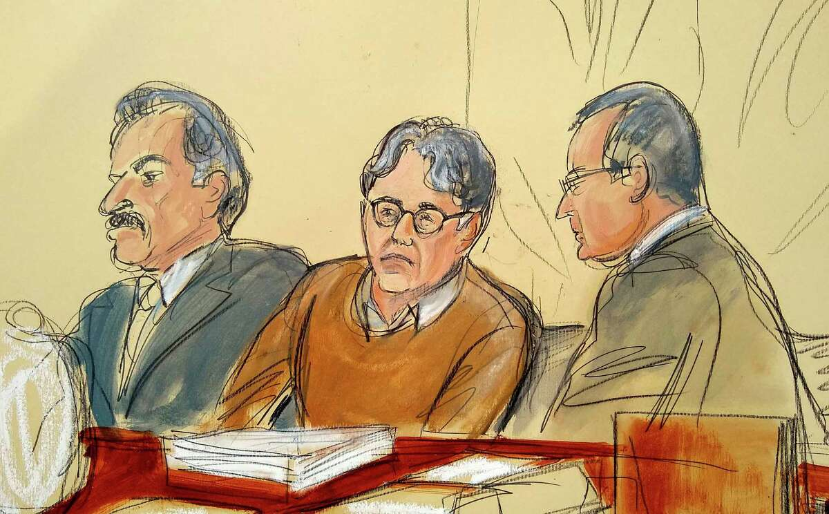In this courtroom drawing, defendant Keith Raniere, center, is seated between his attorneys Paul DerOhannesian, left, and Marc Agnifilo during the first day of his sex trafficking trial, Tuesday, May 7, 2019. Raniere, the former leader of the self help group called NXIVM, has pleaded not guilty to the charges that he turned his followers into sex slaves.