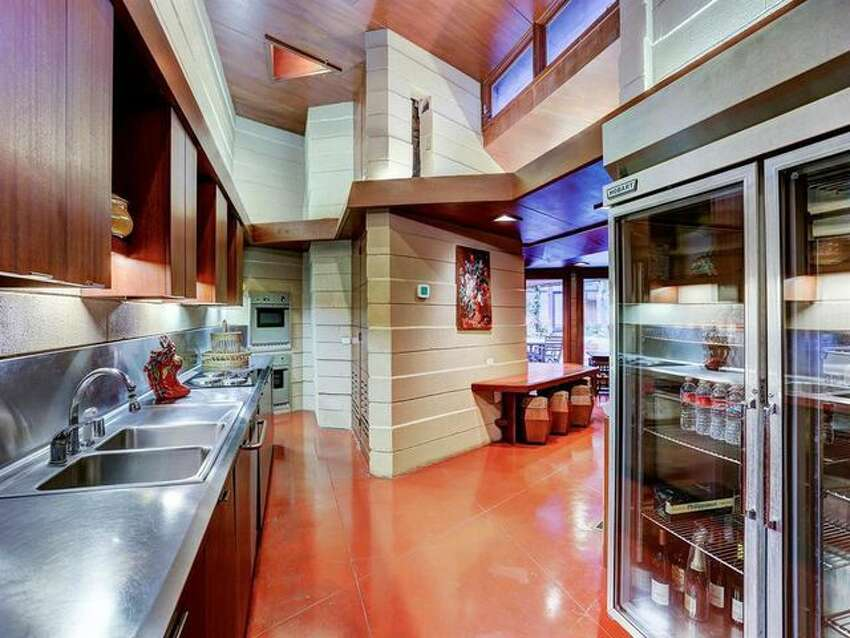 Original structure's kitchen A home designed by famed architect Frank Lloyd Wright is on the market in Houston, Texas, for $2.85 million. What was once a modest 1,800-square-foot home now has five bedrooms and 6.5 baths, thanks to a 6,300-square-foot addition.