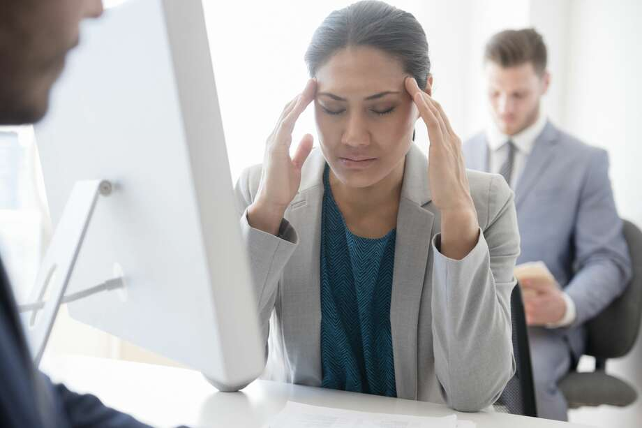 A woman is stressed out by her husband not being able to hold down a job. Photo: JGI/Jamie Grill/Getty Images/Tetra Images RF