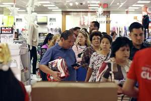 Shoppers wait to checkout at J.C. Penney in North Star Mall on Gray Thursday Nov. 26, 2015.
