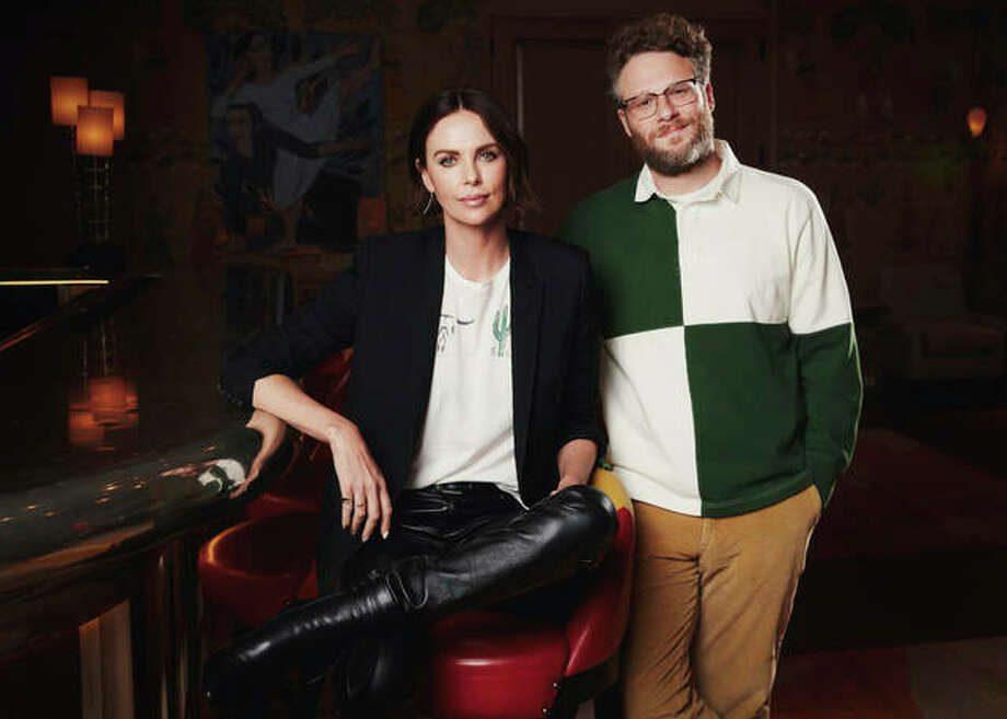 """This April 29, 2019 photo shows co-stars Charlize Theron, left, and Seth Rogen posing for a portrait in New York to promote their film """"Long Shot."""" Photo: Photo By Taylor Jewell/Invision/AP"""