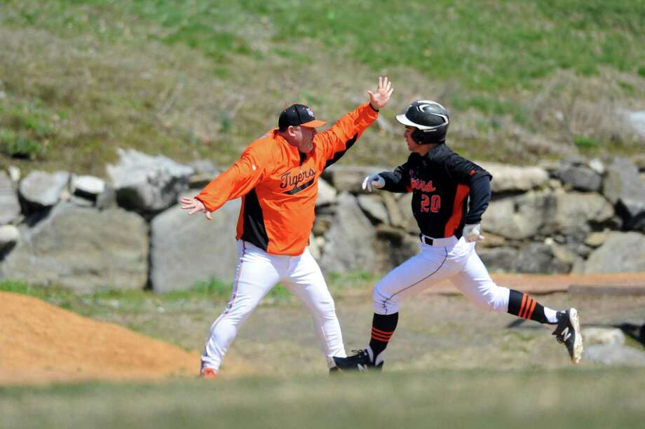 Ridgefield coach Paul Fabbri enthusiastically waves home Nick Hanna during a varsity baseball game against Stamford High School at Stamford High in Stamford, Conn. on Wednesday, April 11, 2018. Photo: Michael Cummo / Hearst Connecticut Media / Stamford Advocate