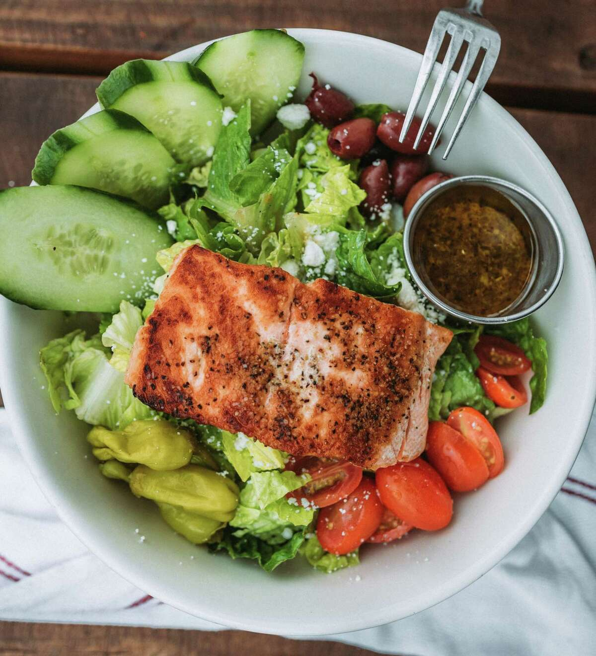 On the Kirb serves a Greek salmon salad made with Romaine, cucumbers, tomatoes, red onion, kalamata olives and feta.