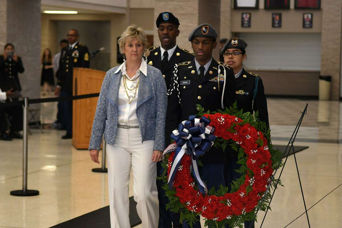 Humble High School Principal Donna Ullrich, front left, SGM David Watkins, Cadet Battalion Commander LtCol Joshua Jordan, and Cadet Command Sergeant Major Gissel Gomez perform the placing of the wreath at the Tomb of the Unknown Soldier replica during the HHS Wildcat Salute to Veterans in the HHS Commons on Nov. 10, 2017. (Photo by Jerry Baker/Freelance)