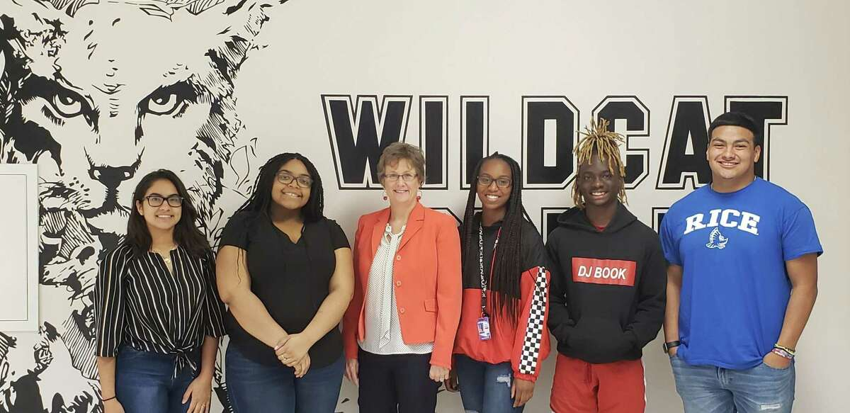 Humble High School Principal (center) poses with HHS students (from left to right): Hennessy Martinez, Anastasia Meziere, Angel Daughtry, Ian Gilmore and Erick Osegueda.
