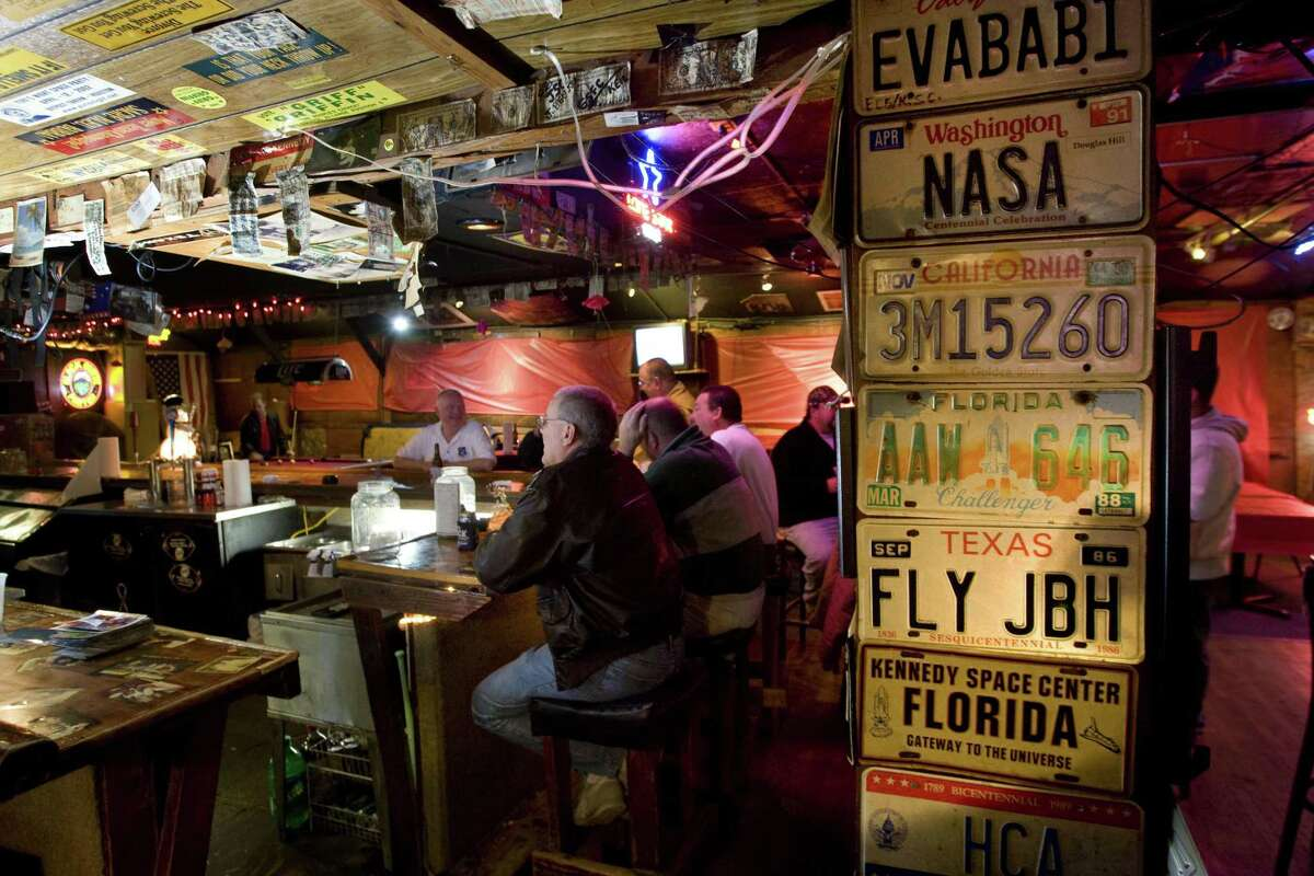 Roger Mitchell sits at the end of the bar at the Outpost Tavern on Dec. 2, 2009, in Webster. A NASA-area hangout for astronauts and regular folks, closed that year but hopes remain it could reopen someday.