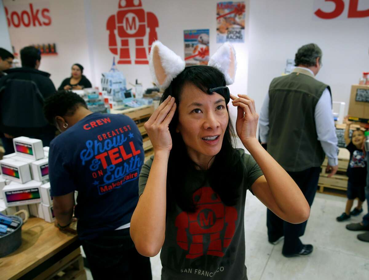 Sonia Wong, general manager of commerce for Maker Media, demonstrates the Brainwave Cat Ears at the Make magazine holiday pop-up store near Union Square in San Francisco, Calif. on Friday, Nov. 20, 2015.