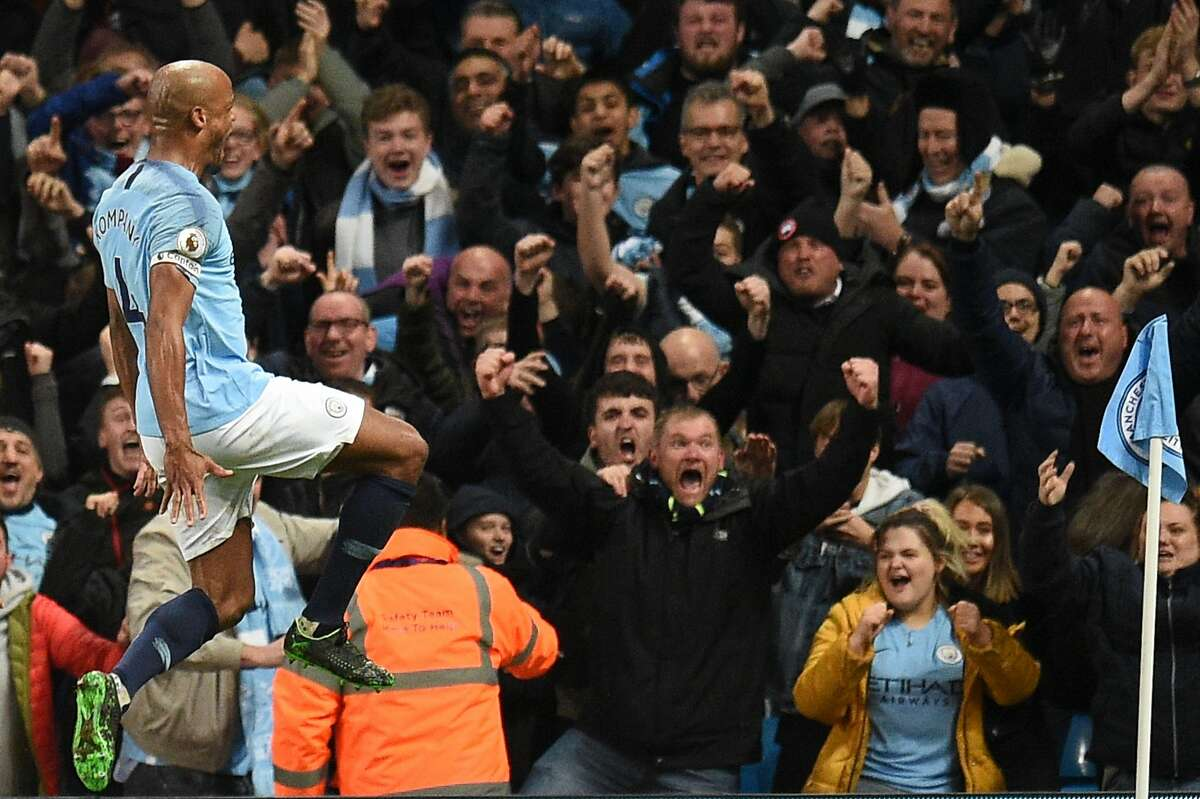 Manchester City's Belgian defender Vincent Kompany celebrates scoring the opening goal during the English Premier League football match between Manchester City and Leicester City at the Etihad Stadium in Manchester, north west England, on May 6, 2019. (Photo by Oli SCARFF / AFP) / RESTRICTED TO EDITORIAL USE. No use with unauthorized audio, video, data, fixture lists, club/league logos or 'live' services. Online in-match use limited to 120 images. An additional 40 images may be used in extra time. No video emulation. Social media in-match use limited to 120 images. An additional 40 images may be used in extra time. No use in betting publications, games or single club/league/player publications. / OLI SCARFF/AFP/Getty Images