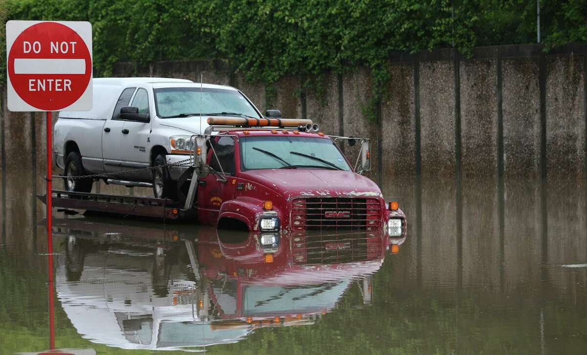 A truck stuck in the flooded intersection of Hardy and Crosstimbers streets after heavy rainfall overnight Friday, May 10, 2019, in Houston.