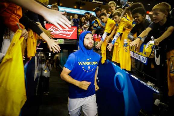 Stephen Curry runs through the tunnel to warm up ahead of Game 5 of the Western Conference Semifinals between the Golden State Warriors and the Houston Rockets at Oracle Arena in Oakland, California, on Wednesday, May 8, 2019.