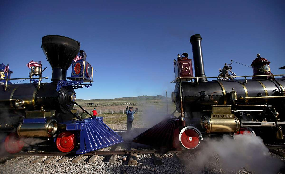 PROMONTORY, UT - MAY 10: The Jupiter (L) and the 119 steam engines makes their way into place for the 150th anniversary of the driving of the Golden Spike on May 10, 2019 in Promontory, Utah. The driving of the Golden Spike completed the Transcontinental Railroad that liked both coast of the United States for the first time. (Photo by George Frey/Getty Images)