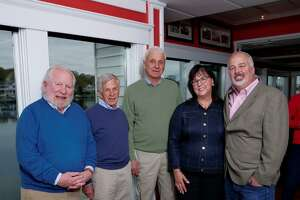 """From left, John McGee, Paul Connor, Wes Maxwell, Judi Caracausa and Walter """"Sonny"""" Glaser Jr. gather in Mystic, Conn. McGee, Connor and Maxwell — the principals of Steamboat Wharf Co. LLC —sold four Mystic, Conn. properties to Glaser for a total of approximately $11.5 million. Caracausa brokered the deal."""