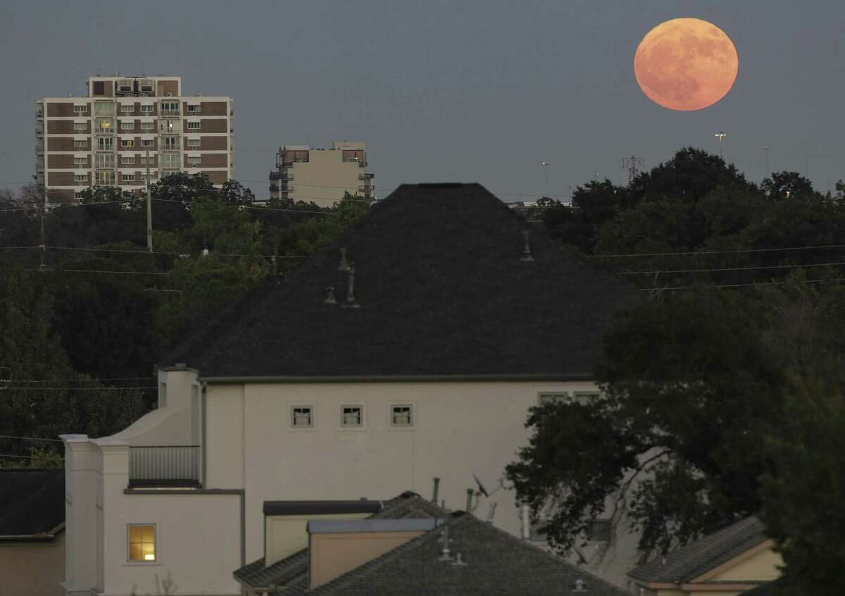 The Harvest Moon rises over the Montrose neighborhood on Sept. 24, 2018 in Houston. The harvest moon is the closest full moon to the autumn equinox, which was on Sept. 22, 2018.