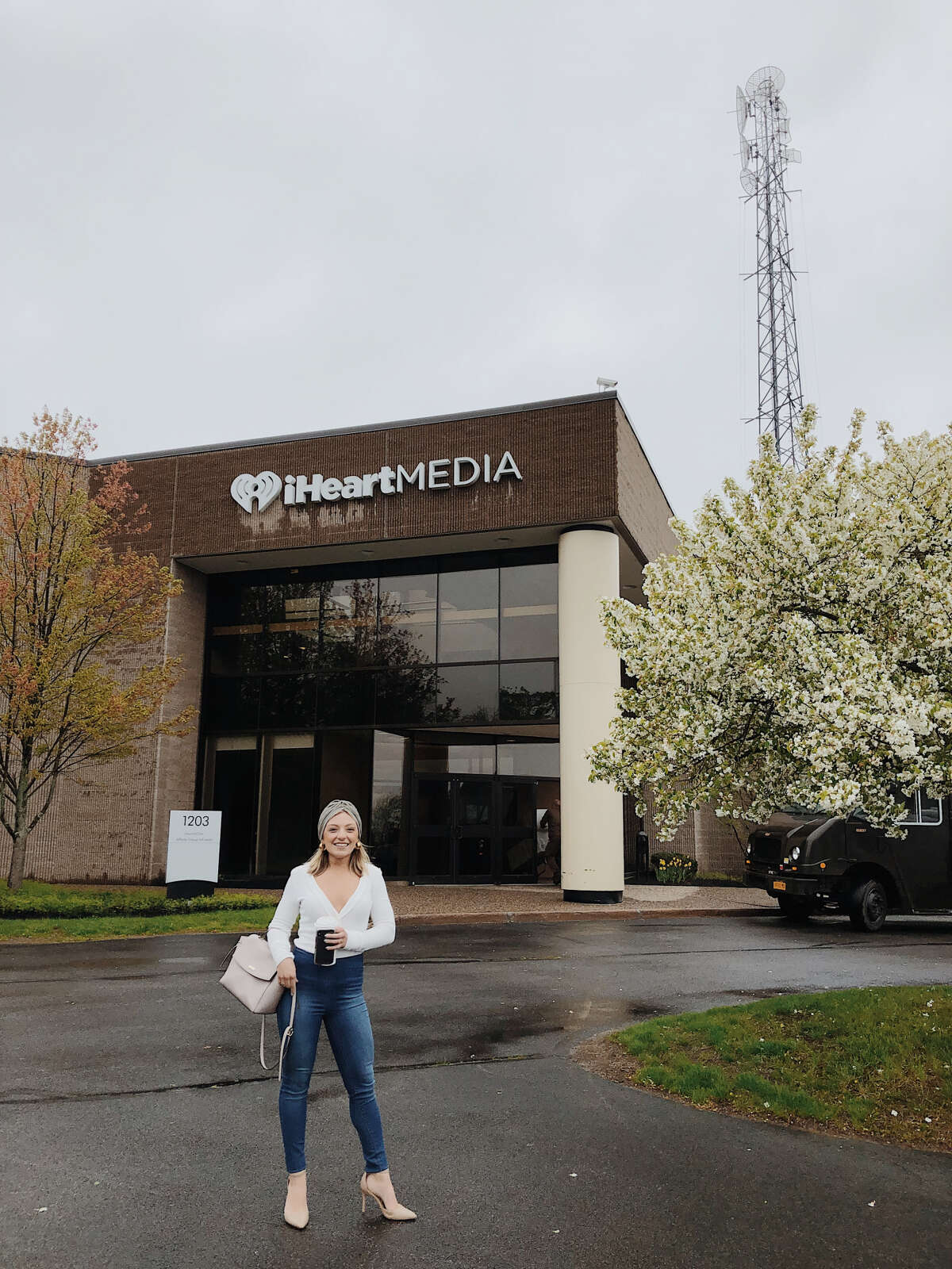 Taylor Rao of Two Buttons Deep stands outside the iHeartMedia building in Latham. She and colleague Jack Carpenter will be on the KISS 102-3 Low Budget Night Show with D Scott from 6 to 8 p.m. each Friday.
