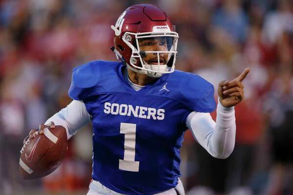 Oklahoma quarterback Jalen Hurts (1) gestures during an NCAA college football intra-squad spring game in Norman, Okla., Friday, April 12, 2019. (AP Photo/Sue Ogrocki)
