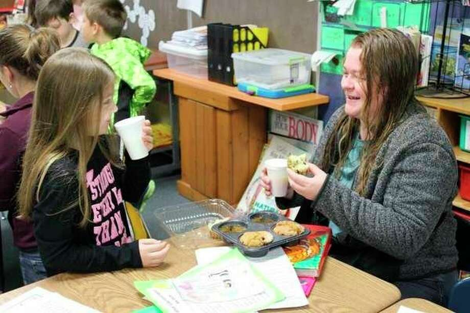 Mothers and their little ones gathered at Bad Axe Elementary on Friday for a special, tasty treat. 'Muffins with Mom' was an early opportunity to celebrate Mother's Day. (Robert Creenan/Huron Daily Tribune)