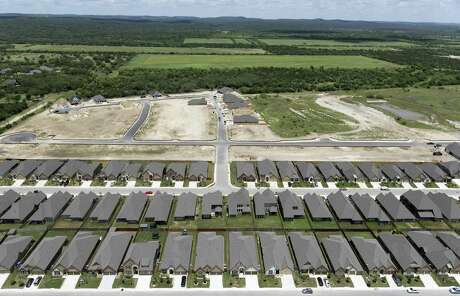 Rows of completed homes stand Wednesday, May 23, 2018 next to another development still under construction on San Antonio's west side north of Culebra Road and west of Loop 1604