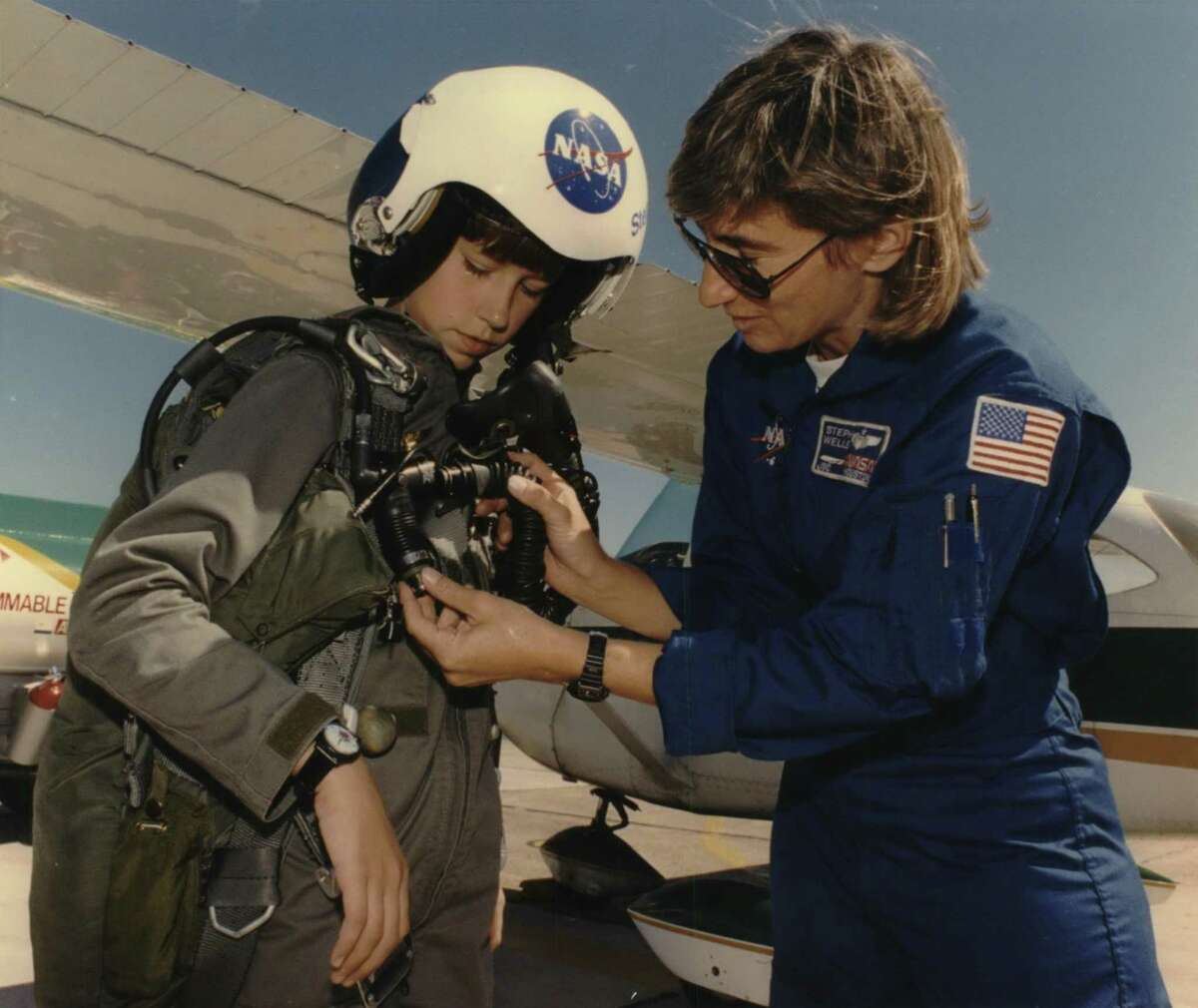 In this 1993 photo from the Houston Post archives, eleven-year-old Victoria Van Meter had one more milestone to complete after finishing her record-setting flight across the country on Sept. 23, 1993. Flying her plane to Houston's Ellington Field she was greeted by NASA pilot Stephanie Wells (R), who let her try on her flight helmet and parachute before touring Johnson Space Center. Van Meter dreamed of becoming an astronaut when she grew up. She died in 2008 at age 26.