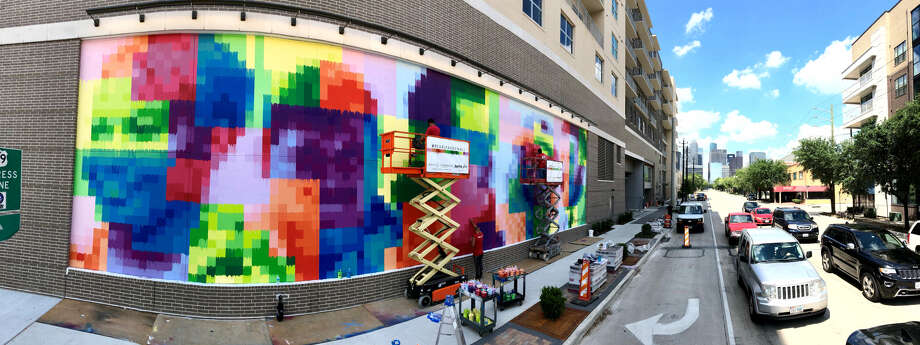 """Morgan has unveiled a new art installation by Sebastien """"Mr. D"""" Boileau at Pearl Marketplace in Midtown. The art mural at 3120 Smith celebrates the construction workers who built the mixed-use project, which contains 264 apartment units above a 40,000-square-foot Whole Foods Market. Photo: Morgan"""