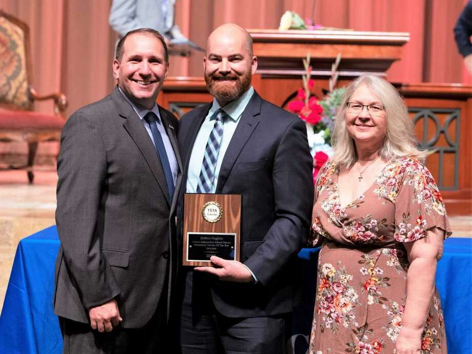 Joshua Hughes, who teaches at Vogel Intermediate, was awarded the district's Elementary Teacher of the Year award at the Conroe ISD's annual Salute to Education ceremony Thursday at The Woodlands United Methodist Church. Here, Hughes stands with Superintendent Curtis Null and Texas State Teachers Association—Conroe President Cheryl Dentler. Photo: Submitted Photo / Submitted Photo