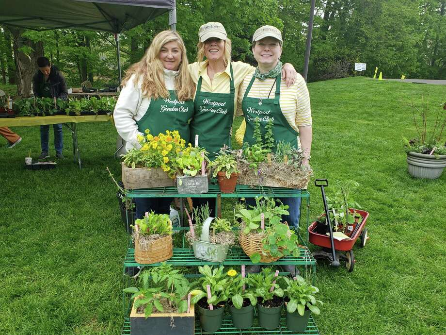 Plant Sale Chair Kathy Oberman Tracy, co-chair Kara Wong and Westport Garden Club President Kelle Ruden stand with flowers plants for sale at the group's annual fundraiser on the Saugatuck Congregational Church lawn in Westport on May 10, 2019. Photo: Liana Teixeira / Hearst Connecticut Media