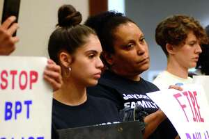 "In a file photo from last summer, Jayson Negron's half-sister Jazmarie Melendez, holding the ""Stop Killing Us"" sign, protested with the Justice for Jayson Coalition during a Bridgeport Police Commission meeting."
