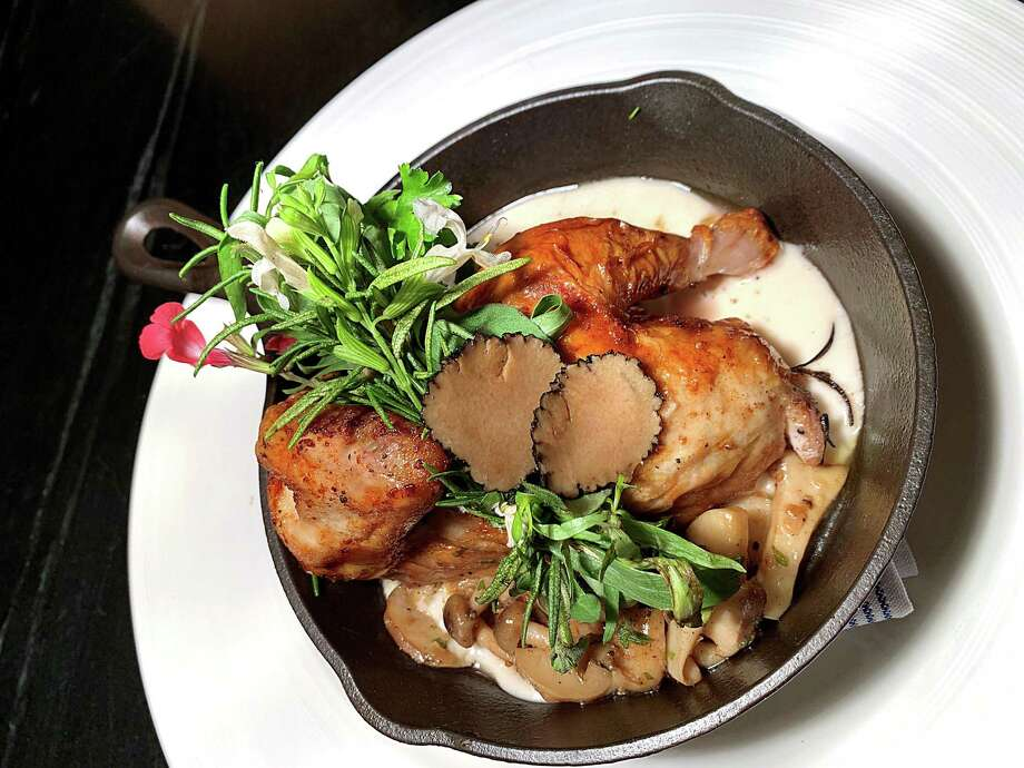 Roasted chicken with foie gras, truffle honey butter, mushrooms and white beans is part of the new spring menu at Savor, the student-run restaurant at The Culinary Institute of America, San Antonio. Photo: Regina Pyne