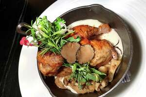 Roasted chicken with foie gras, truffle honey butter, mushrooms and white beans is part of the new spring menu at Savor, the student-run restaurant at The Culinary Institute of America, San Antonio.