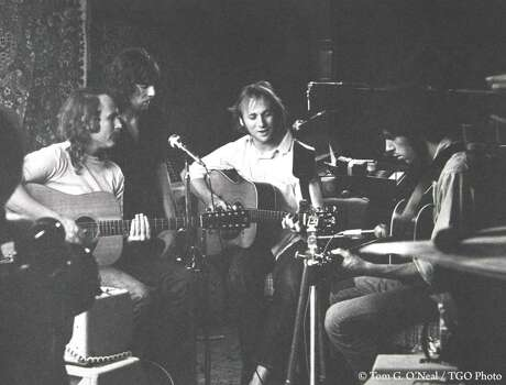 """CSNY - David Crosby (far left), Stephen Stills (center right), Graham Nash (center left) and Neil Young (far right) - rehearse in Studio City in 1969 for Woodstock. """"They renovated Peter Tork's garage by hanging oriental rugs up on the walls for sound,"""" recalled photographer Tom O'Neal."""