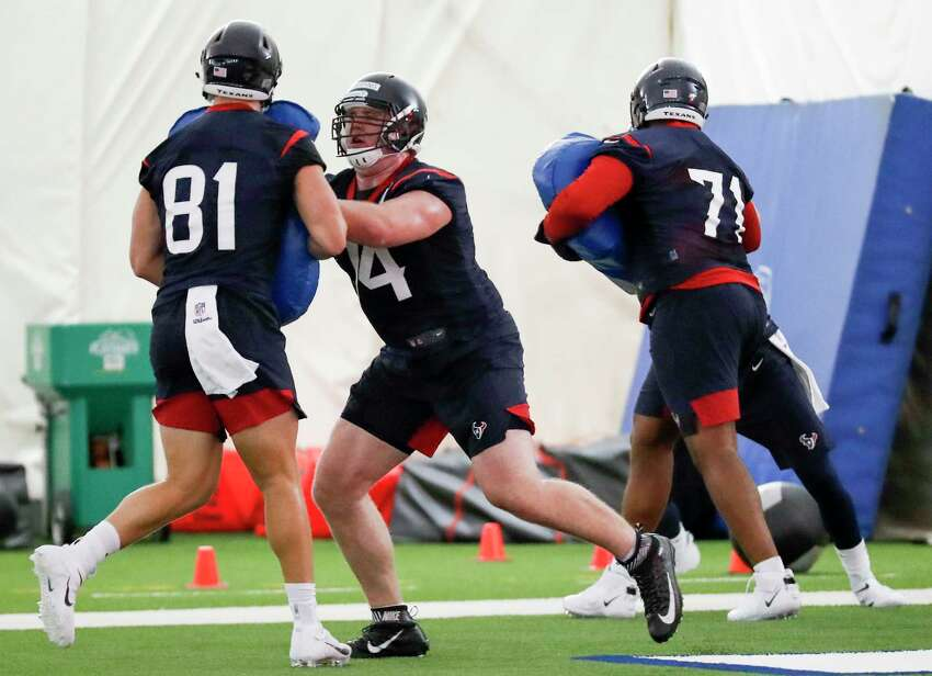 Houston Texans tackle Max Scharping (74) blocks tight end Kahale Warring (81) while running a blocking drill during rookie mini camp at The Methodist Training Center on Friday, May 10, 2019, in Houston.