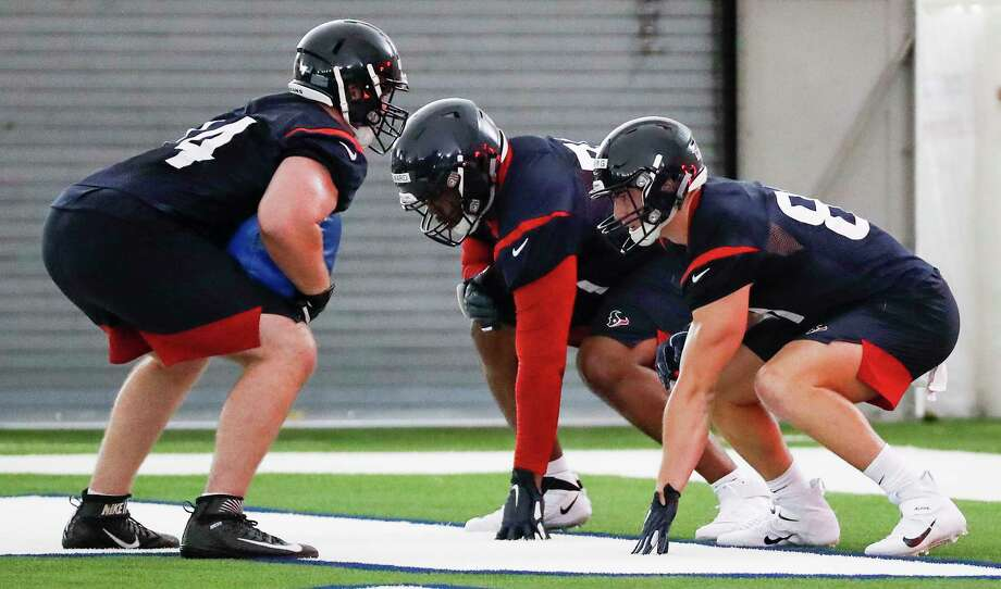 Houston Texans tackle Max Scharping (74), tackle Tytus Howard (71) and tight end Kahale Warring (81) line up to run a blocking drill during rookie mini camp at The Methodist Training Center on Friday, May 10, 2019, in Houston. Photo: Brett Coomer, Staff Photographer / © 2019 Houston Chronicle