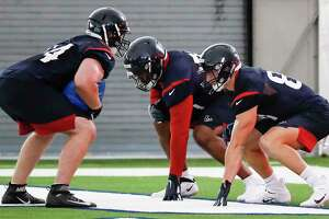 Houston Texans tackle Max Scharping (74), tackle Tytus Howard (71) and tight end Kahale Warring (81) line up to run a blocking drill during rookie mini camp at The Methodist Training Center on Friday, May 10, 2019, in Houston.
