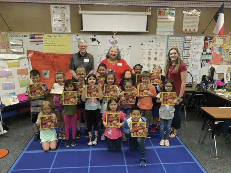 "Jim and Sylvia Wiggins are pictured with a class of first graders at Rice Elementary school in Conroe. On Tuesday morning, the Wiggins distributed ""I Like Me"" books at the school as a project of the Rotary Club of Conroe."