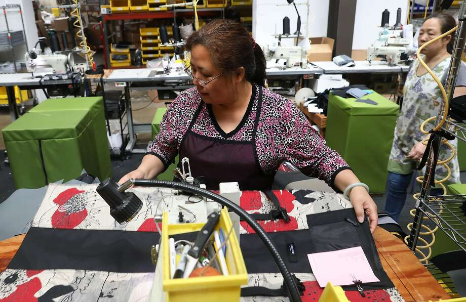 Timbuk2 has a manufacturing facility in San Francisco's Mission District, where workers make custom orders. Photo: Liz Hafalia / The Chronicle