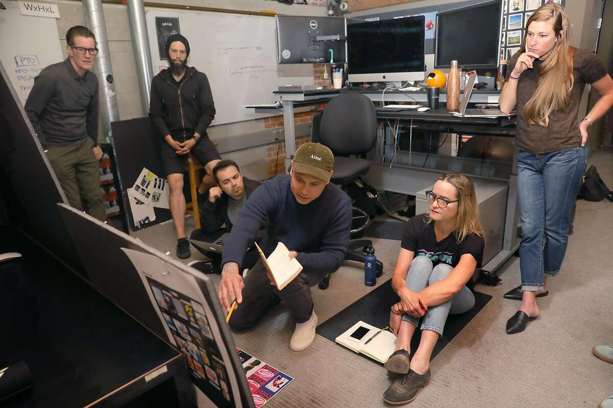 Timbuk2 global creative director Andrea Chynoweth (glasses seated at right) and brand manager Michelle Nadeau (right)) meet with the design staff at headquarters on Thursday, April 11, 2019, in San Francisco, Calif.