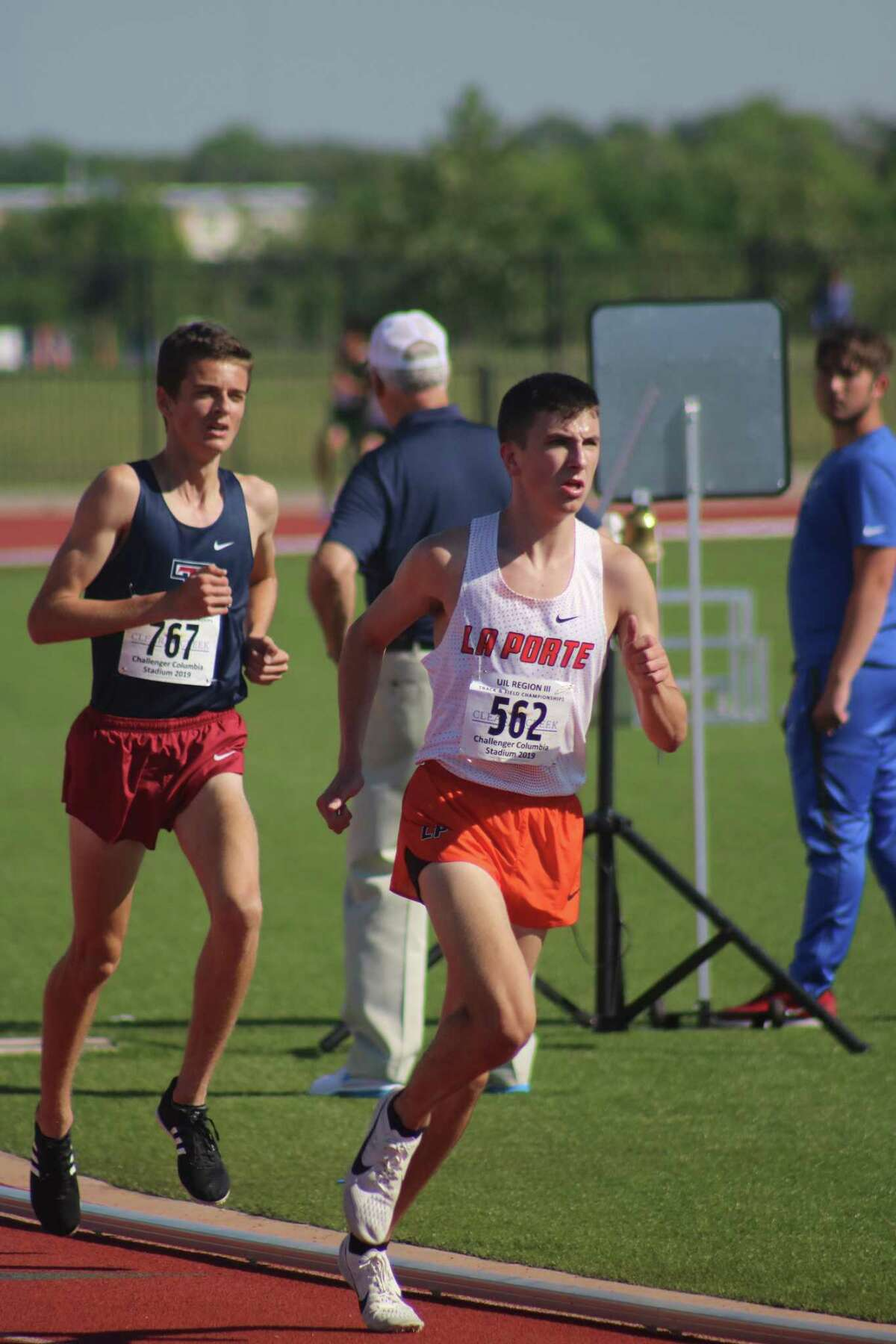 La Porte's Ryan Schoppe stays a step ahead of Katy Tompkins' Cole Lindhorst during the Region III 3200-meter run at Challenger Columbia Stadium. The one-time Fairmont Junior High student set a PR when he was clocked at 9:03.86. Both will be in the state championship race.