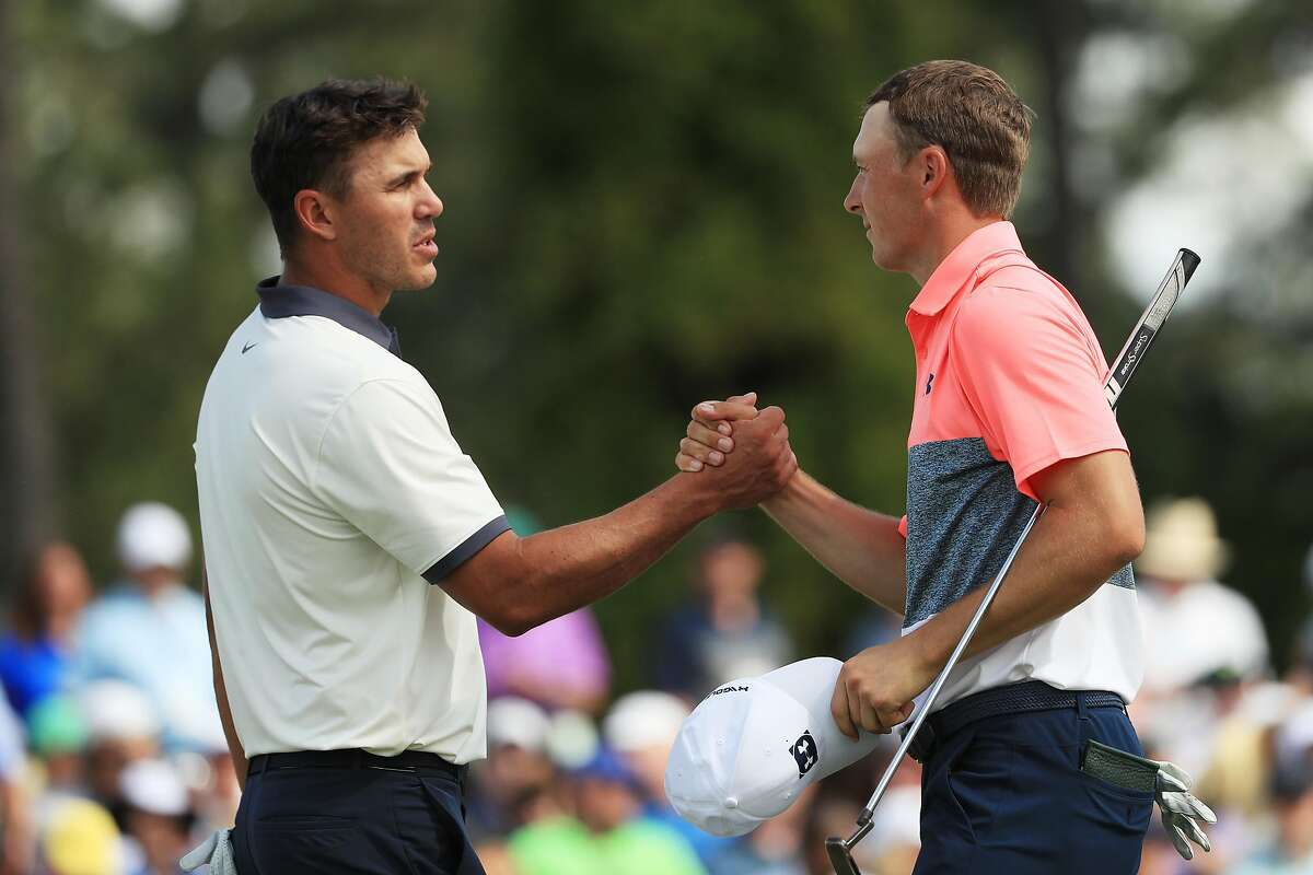 AUGUSTA, GEORGIA - APRIL 12: Brooks Koepka and Jordan Spieth of the United States shake hands after finishing on the 18th green during the second round of the Masters at Augusta National Golf Club on April 12, 2019 in Augusta, Georgia. (Photo by Mike Ehrmann/Getty Images)