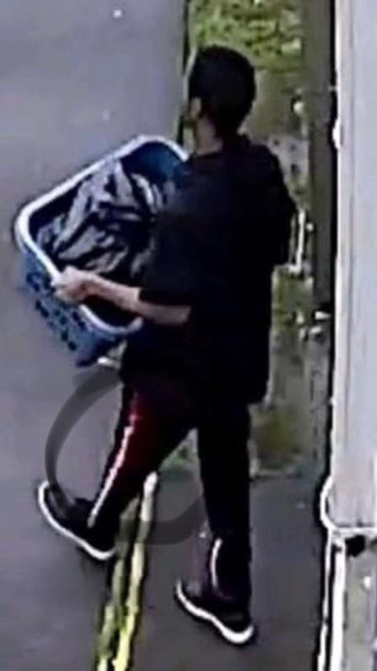 Screenshot taken from surveillance video that Maleah Davis' mother says is of Darion Vence leaving his apartment with a laundry basket and black bag.
