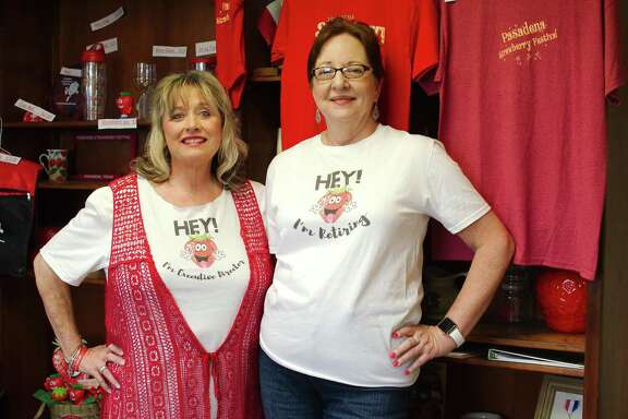 Incoming Pasadena Strawberry Festival executive director Murline Staley, left stands with retiring director Bert Mustin, who has been involved with the event for 29 years.