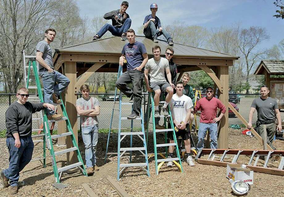 The shelter at the Guilford Dog Park was built by Guilford High School students, including (l-r) bottom row: Aaron Ignatowski, Chandler Reeves, Joe Walters, JP Murtagh, Jack Alviti, Jackson Mangels, Aidan Chiaia, Josh Wetterman, along with teachers David Hackett and Tom Schaefer and on the roof: Elijah Dillon and Chase Martin. Photo: Contributed Photo