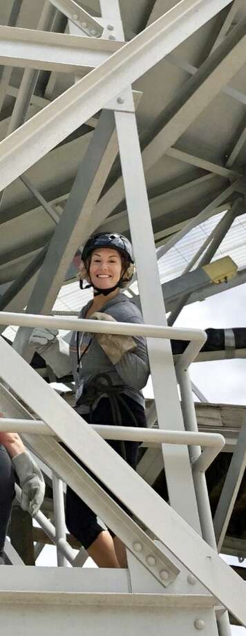 East Haven Superintendent of Schoosl Erica Forti (she also features in story) on her way to top of rappel tower. Photo: Lisa Reisman