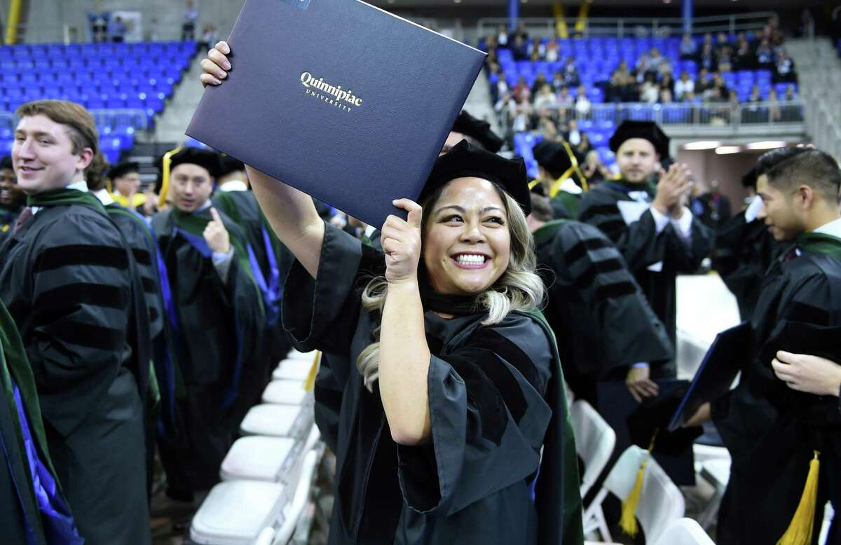 Corrinne Eugenio celebrates after receiving her Doctor of Medicine degree at the Frank H. Netter MD School of Medicine Commencement Exercises at Quinnipiac University's People's United Center in Hamden on May 10, 2019.