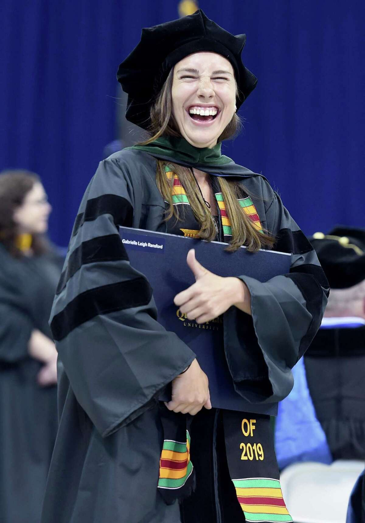 Gabrielle Ransford gives the thumbs up after receiving her Doctor of Medicine degree at the Frank H. Netter MD School of Medicine Commencement Exercises at Quinnipiac University's People's United Center in Hamden on May 10, 2019.