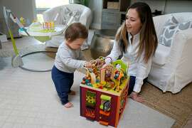 """Lauren McClelland spends time with her 10-month-old son Lucas Gunn at their home in San Rafael, Calif. on Friday, May 10, 2019. McClelland's employer PwC provided a """"phased return"""" program during her maternity leave of absence."""