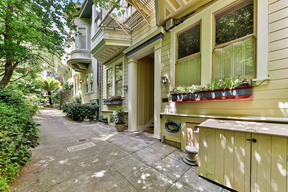 """A cozy and sunny one-bedroom, one-bathroom condo is tucked away at 66 Macondray Lane, the fabled alleyway that inspired Armistead Maupin to write """"Tales of the City."""" Photo: Open Homes Photography"""