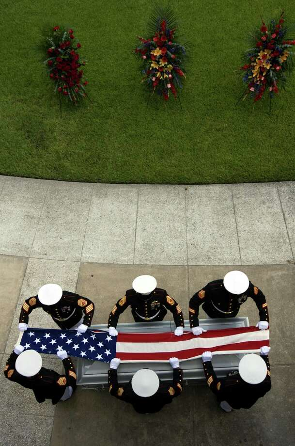 Marine Corps Color guard folds the flag above the casket of LCpl. Shane R. Martin, 23, of Spring, Texas during burial services at Houston National Cemetery Aug. 9, 2010, in Houston. LCpl. Martin is survived by his wife Lauren. Surviving military spouses in Texas are denied benefits they are eligible for due to the SBP/DIC offset. Photo: Johnny Hanson /AP / Houston Chronicle