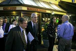 The report by Robert Mueller — second from left, seen in Georgetown on May 6 — is all Congress needs to make an impeachment decision after the special counsel decline o decide whether the president was guilty of a crime.