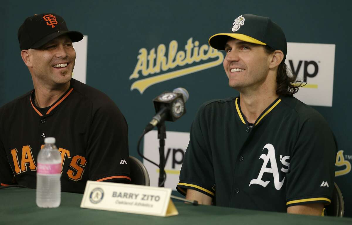 San Francisco Giants pitcher Tim Hudson, left, and Oakland Athletics pitcher Barry Zito smile during a media conference prior to their baseball game Friday, Sept. 25, 2015, in Oakland, Calif. (AP Photo/Ben Margot)